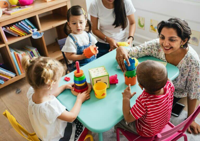 nursery-children-playing-with-teacher-in-the-class-CCD6LW4
